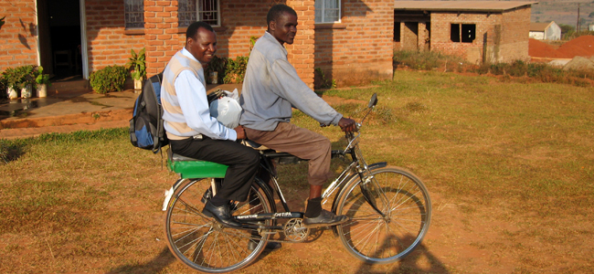 Two men on a bicycle in Malawi