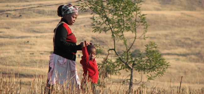 lady and child walking in the veld
