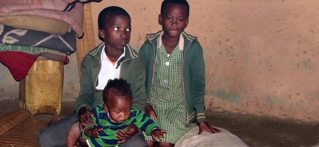 poor children sitting in their kraal